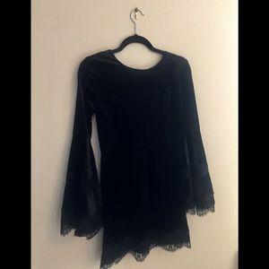 Black velvet Aqua dress with bell sleeves.